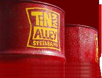 zwei rote faesser mit Logo der Tin Pan Alley Steelband